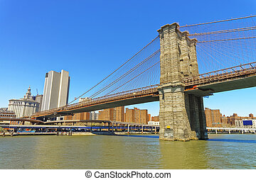 View of Brooklyn bridge over East River - View from Ferry on...