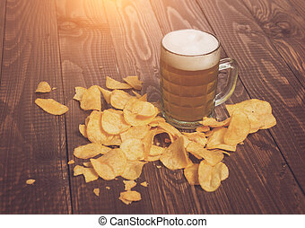 Frothy beer and chips - The frothy beer with crunchy chips