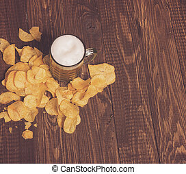 Chips and frothy beer - The frothy beer with crunchy chips...