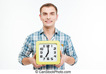Portrait of happy attractive young man with big clock -...