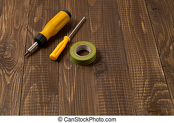 Necessary locksmiths tools for work are on the wooden table