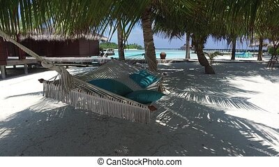 hammock at hotel resort on tropical beach
