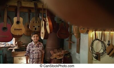1-Boy In Lute Maker Shop Watching Classic Guitars - Young...