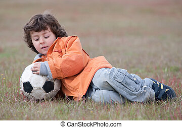 Child playing with a soccer ball