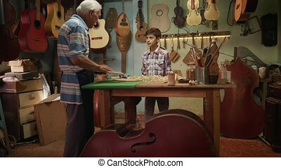 6-Lute Maker Grandpa Teaching Grandson Chiseling Wood - Old...