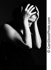 Woman prays on a black background - Beautiful woman prays...