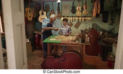 10-Old Man Luter Teaching Grandson Boy Chiseling Wood - Old...