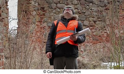 Building inspector using tablet PC at old ruins