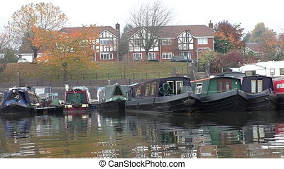 Canal boats in marina in autumn - Colourful reflections of...