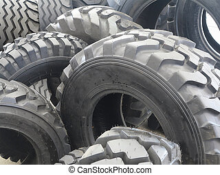 New black tractor abstract tire wheels background