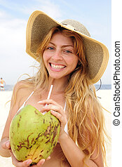thirsty woman drinking coconut water on the beach - thirsty...