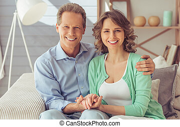 Beautiful couple at home - Happy beautiful couple is...