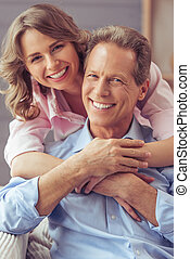Beautiful couple at home - Portrait of happy beautiful...
