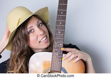 Attractive woman with a guitar