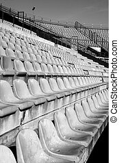 aged seats in football stadium perspective