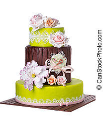 Tiered wedding cake with roses Decorations on the wedding...