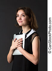 young beautiful girl holding touch pad