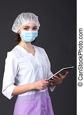young nurse holding touch pad