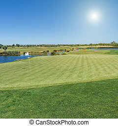 Golf course with a collar for the balls - A golf course with...