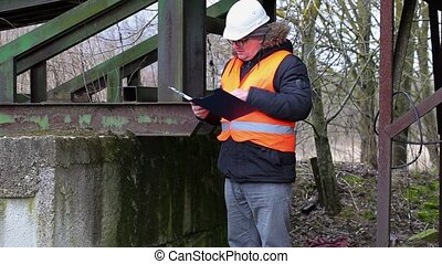 Engineer with documentation checking territory