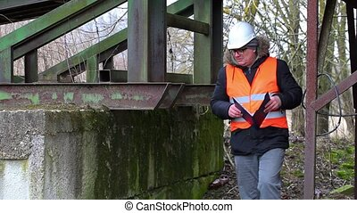 Engineer with documentation at old factory
