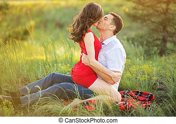 Hot young couple kissing in park