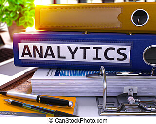 Analytics on Blue Ring Binder. Blurred, Toned Image. -...