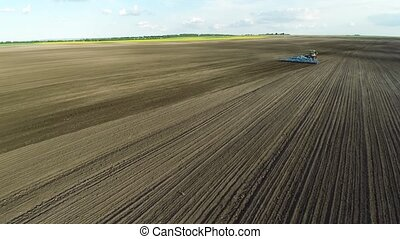 Field tractor aerial sky