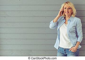 Beautiful mature woman with gadget - Beautiful mature woman...