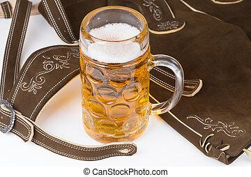 traditional Bavarian pants deerskin and a mug of beer
