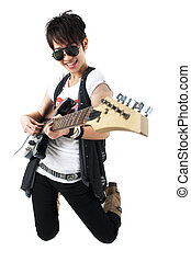 Punk Rockstar holding a guitar kneeling isolated in white