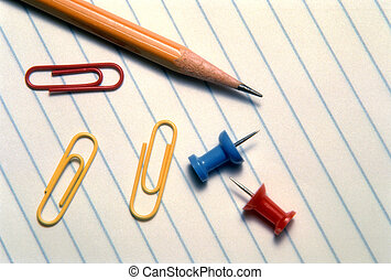 Paper, Pencil, Pushpins and Paper Clips - A pencil, paper...