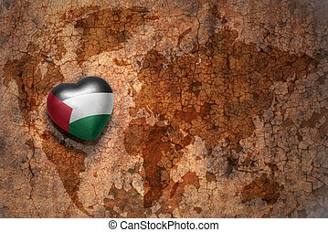 heart with national flag of palestine on a vintage world map...