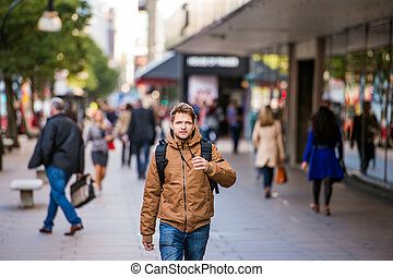 Hipster man walking in the streets of London - Young hipster...
