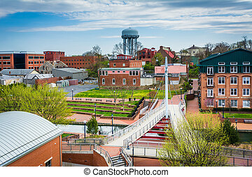 View of buildings and Carroll Creek Park, in Frederick,...