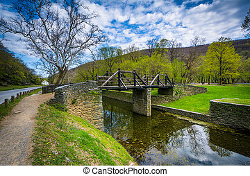 Wooden bridge over the Shenandoah Canal, in Harpers Ferry,...