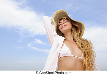 summer: woman with straw hat  and copy space