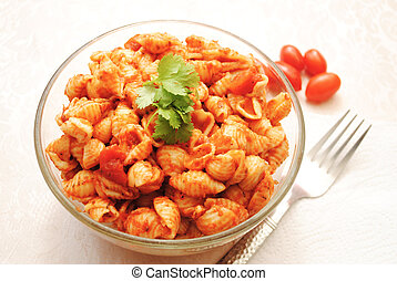 Served Shell Pasta with Sauce in a Glass Bowl
