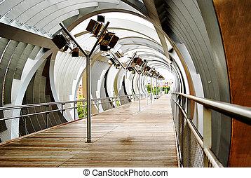 Fantastic view on a metal walking bridge in Madrid Spain -...