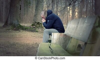 Lonely, depressed man in the park