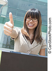 business women - asian business women with a laptop and...