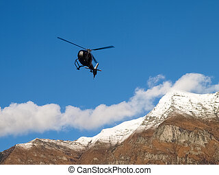 flying elicopter by the dam - Dam of Contra Verzasca Ticino,...