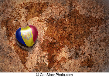 heart with national flag of andorra on a vintage world map...