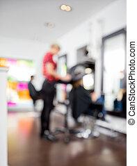 Defocused Image Of Hairdresser With Customers - Defocused...
