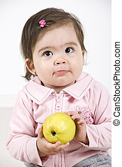 Silky baby holding an apple - Silky baby girl holding a...