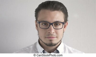 Portrait Of Attractive Young Man With Glasses Standing On...