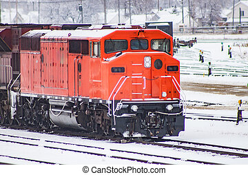 A Red Locomotive in a Railway Yard - A red locomotive in a...