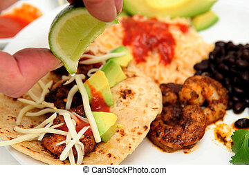 Squeezing Lime On Shrimp Taco - Shrimp cooked in Jamaican...