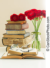 Old books with rose flower - Stack of old books with red...