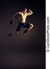 striving upwards - Handsome muscular male athlete doing high...